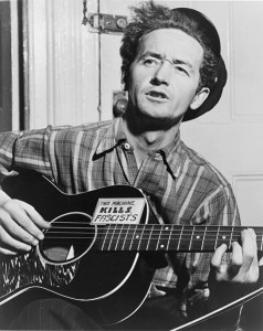 477px-Woody_Guthrie_NYWTS-238x300