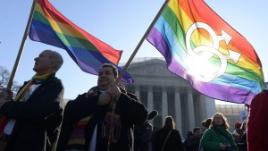 photo credit Rainbow flags outside the Supreme Court in 2013. Image: EPA/MICHAEL REYNOLDS