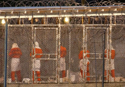 caged_prisoners1_0.jpg