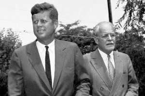 Sen. John F. Kennedy, (left), and Allen W. Dulles, Central Intelligence Agency (CIA) director, walks towards newsmen on the lawn of the Democratic presidential candidates in Hyannis Port, MA., home on July 23, 1960. The two men held a news conference after Senator Kennedy was briefed by Dulles on international affairs. (AP Photo/WCC)